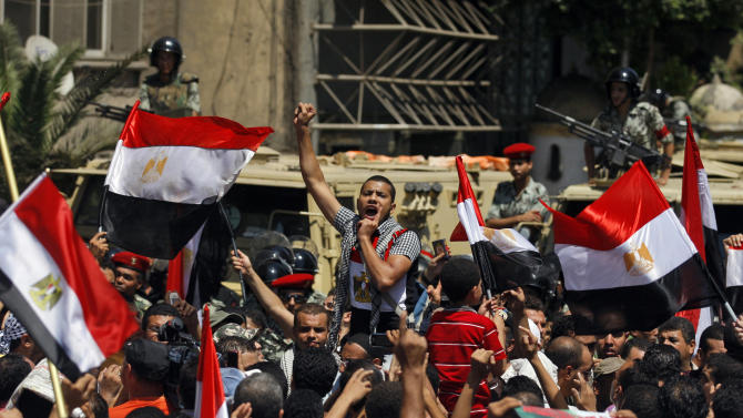 A demonstrator chants anti Israeli slogans during a protest in front of the Israeli embassy in Cairo, Egypt, Friday, Aug. 26, 2011. Hundreds of Egyptians protested the deaths of Egyptian security forces killed last week in the Sinai, as they called for the expulsion of the Israeli ambassador to Egypt. (AP Photo/Khalil Hamra)