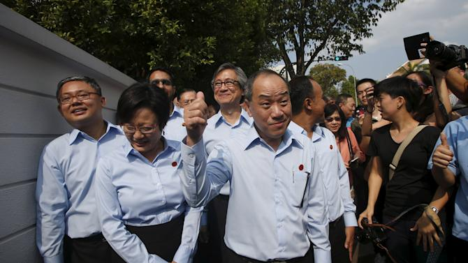 Workers' Party (WP) secretary-general Low Thia Khiang gestures to his team of candidates as they arrive to submit papers during nomination day, ahead of the general elections in Singapore