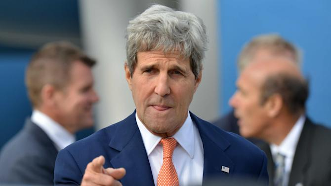 "In this Monday, Aug. 11, 2014 file photo, U.S. Secretary of State John Kerry points a finger as he arrives in Sydney. In its latest personal attack on a prominent official, North Korea has called Kerry a wild dog with a ""hideous lantern jaw."" (AP Photo/Peter Parks, Pool)"