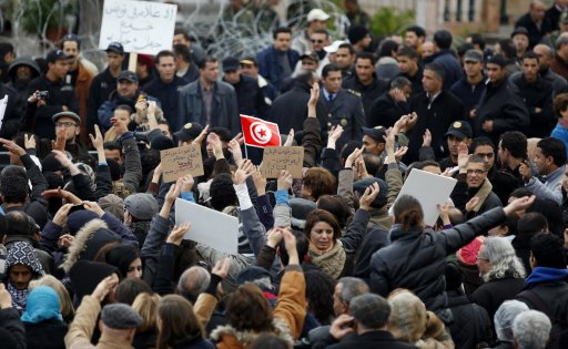 Tunisian journalists protest against recent government appointments in front of the Prime Minister's office in Tunis