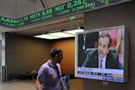 &lt;p&gt;An employee at the Athens stock exchange walks past a television showing Antonis Samaras, the country&#39;s newly elected prime minister. Troubled eurozone nations agreed to act quickly to save Spain&#39;s banks, and to send international creditors to Greece for an update from the new government.&lt;/p&gt;