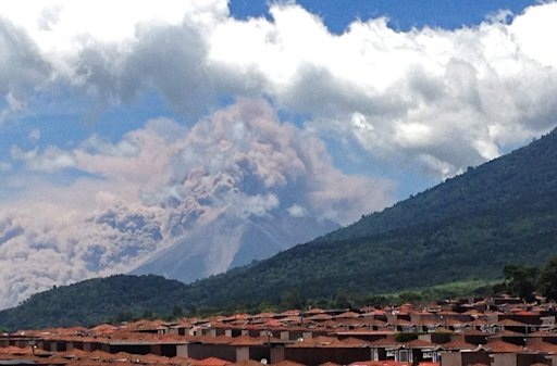 "In this image with a cell phone plumes of smoke rise from the Volcan de Fuego or Volcano of Fire spews ash seen from Palin, south of Guatemala City, Thursday, Sept. 13, 2012. The volcano is spewing lava and ash and the director of the national disaster agency says officials are carrying out ""a massive evacuation of thousands of people"" in five communities. (AP Photo/Moises Castillo)"