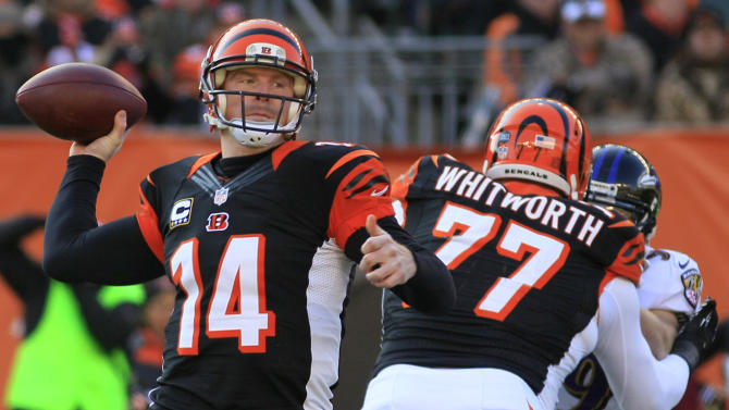 Cincinnati Bengals quarterback Andy Dalton (14) passes against the Baltimore Ravens in the first half of an NFL football game on Sunday, Dec. 30, 2012, in Cincinnati. (AP Photo/Tom Uhlman)