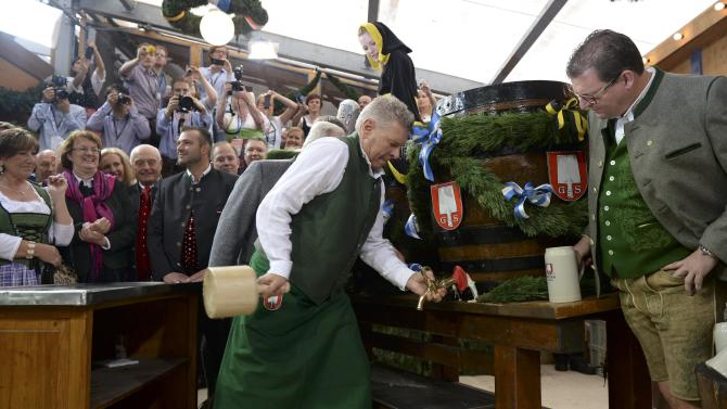 Newly elected mayor of Munich Reiter taps first barrel of beer during opening ceremony for 181st Oktoberfest in Munich