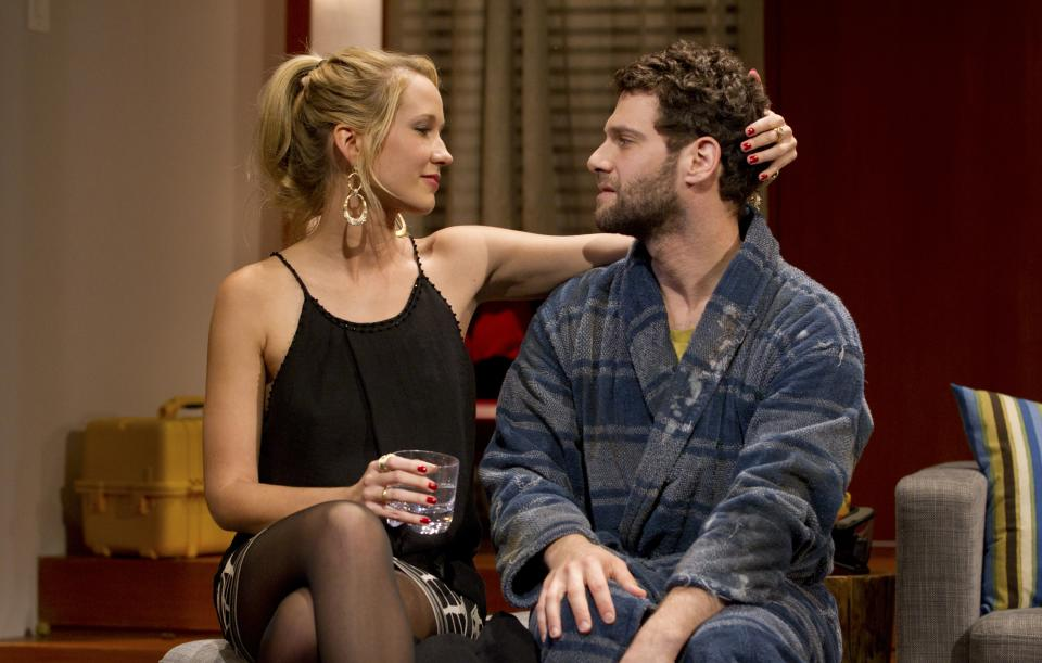 "In this theater publicity image released by The Hartman Group, Anna Camp, left, and Justin Bartha are shown in a scene from Zach Braff's play, ""All New People,"" in New York. (AP Photo/The Hartman Group, Joan Marcus)"