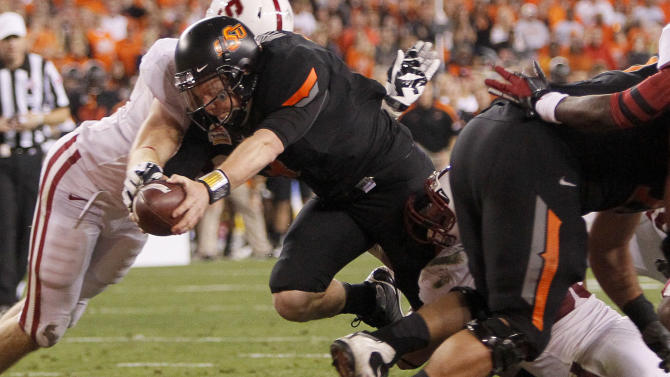 Oklahoma State quarterback Brandon Weeden lunges across the goal line for a touchdown against Stanford during the first half of the Fiesta Bowl NCAA college football game Monday, Jan. 2, 2012, in Glendale, Ariz. (AP Photo/Matt York)