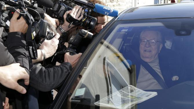 France's far-right National Front political party founder and honorary president Jean-Marie Le Pen sits in his car as he arrives to attend the party's executive office at the headquarters in Nanterre near Paris