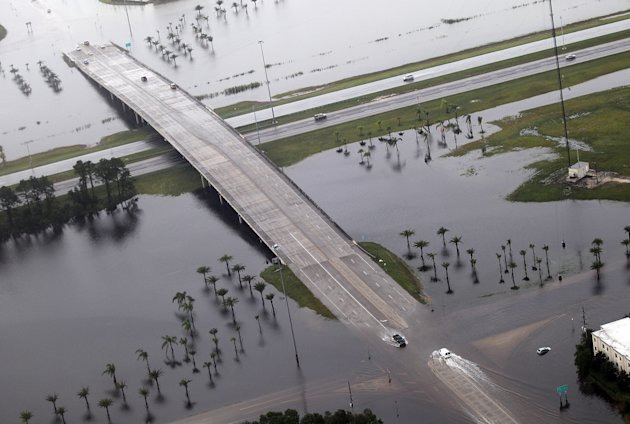 The exits off of I-10 in Slidell, La. are flooded in the aftermath of  Isaac on Thursday, Aug. 30, 2012. Isaac hovered over Louisiana for a third day Thursday, shedding more than a foot of additional