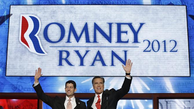 Republican presidential nominee Mitt Romney joined by Republican vice presidential nominee, Rep. Paul Ryan, waves to delegates after speaking at the Republican National Convention in Tampa, Fla., on Thursday, Aug. 30, 2012. (AP Photo/Charles Dharapak)