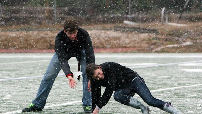 ACA students Phillip Brooks, 17, and Chandler Dare, 17, play in the snow on the school's football field in Tuscaloosa, Ala., Thursday, Jan. 17, 2013. Heavy snow fell across Tuscaloosa County Thursday. (AP Photo/Tuscaloosa News, Michelle Lepianka Carter)