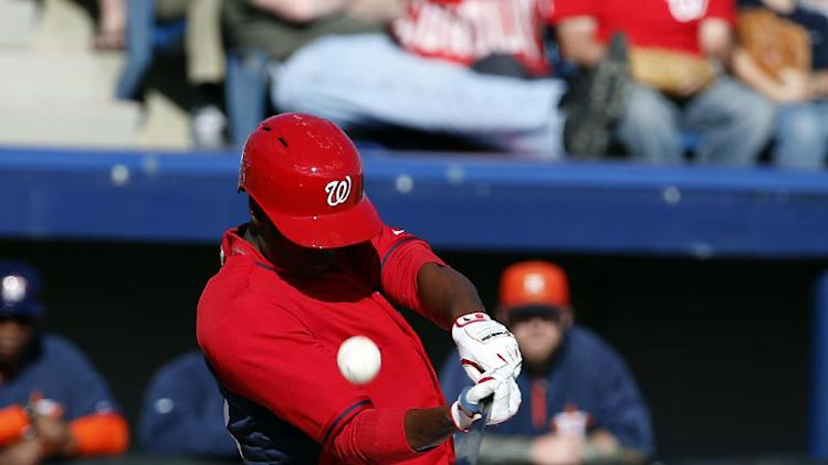Washington Nationals center fielder Michael Taylor (68) bats in a spring exhibition baseball game against the Houston Astros, Friday, March 7, 2014, in Viera, Fla. The Nationals won 8-5. (AP Photo/Alex Brandon)