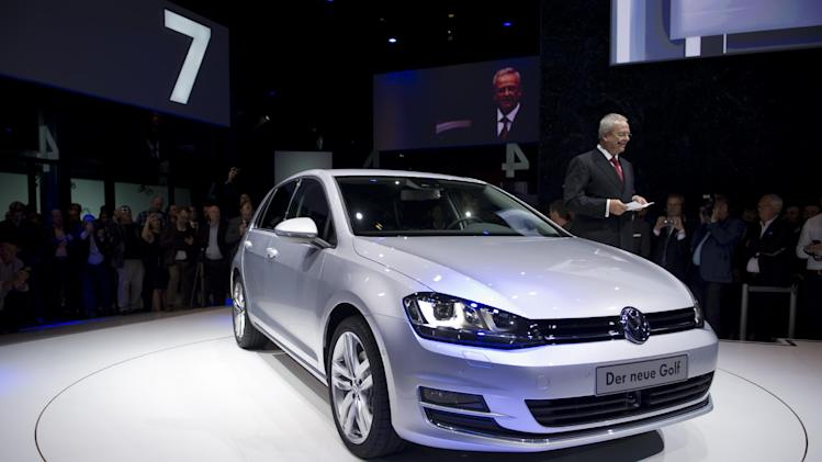 Volkswagen CEO Martin Winterkorn stands next to the new Volkswagen Golf 7 car during the model's launch in Berlin, Tuesday, Sept. 4, 2012 (AP Photo/dapd, Steffi Loos)