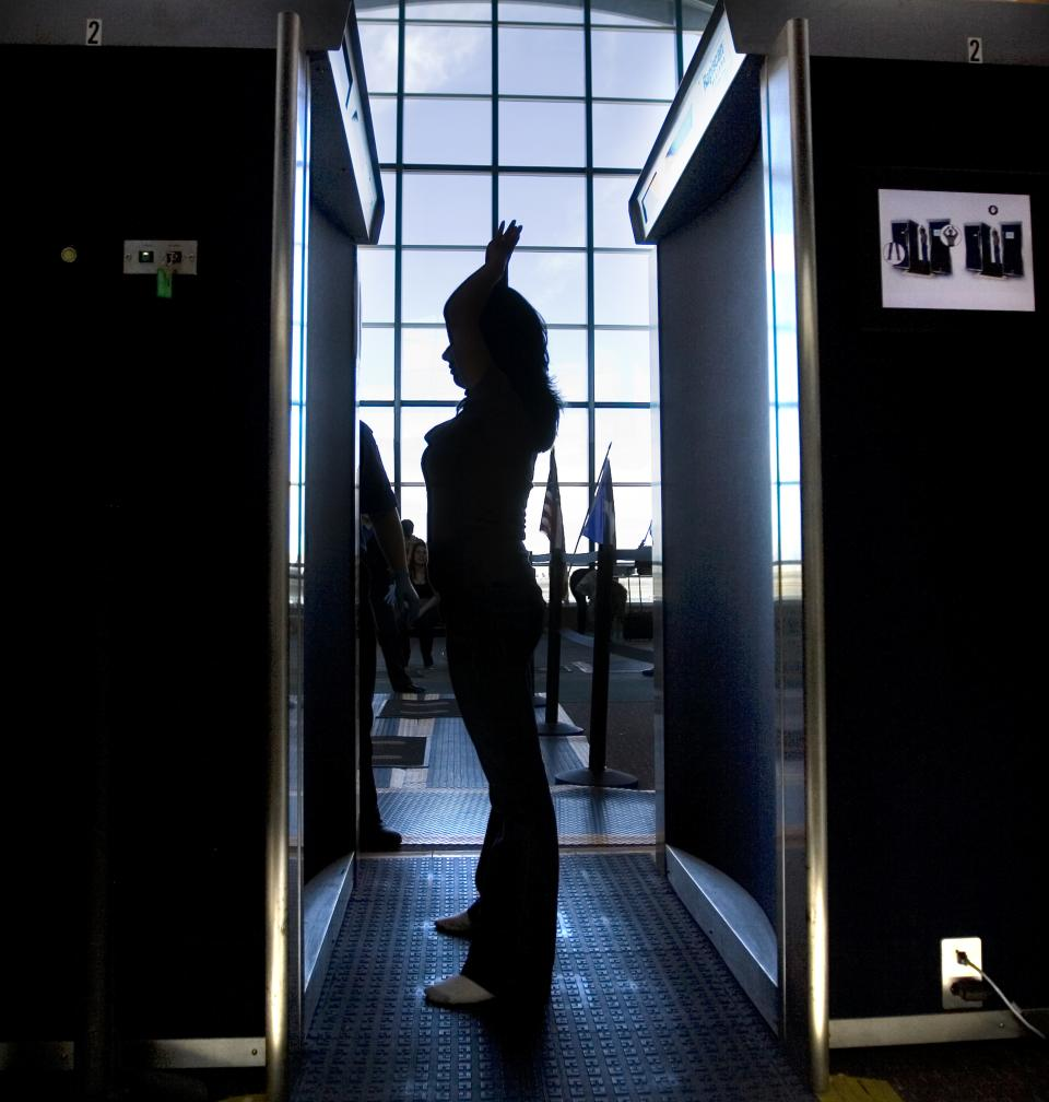 An unidentified passenger participates in a full-body scan at the El Paso International Airport Wednesday, Nov. 24, 2010 on the busy holiday travel day in El Paso, Texas. (AP Photo/The El Paso Times,  Mark Lambie)