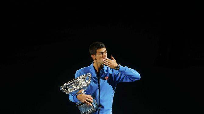 Djokovic of Serbia blows a kiss following his defeat of Murray of Britain to win their men's singles final match at the Australian Open 2015 tennis tournament in Melbourne