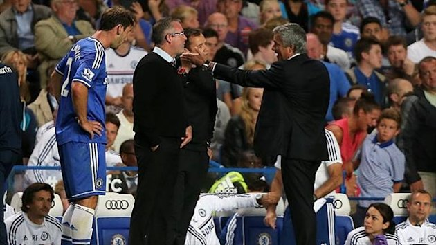 Paul Lambert, second left, and Jose Mourinho, right, had words on the Stamford Bridge touchline