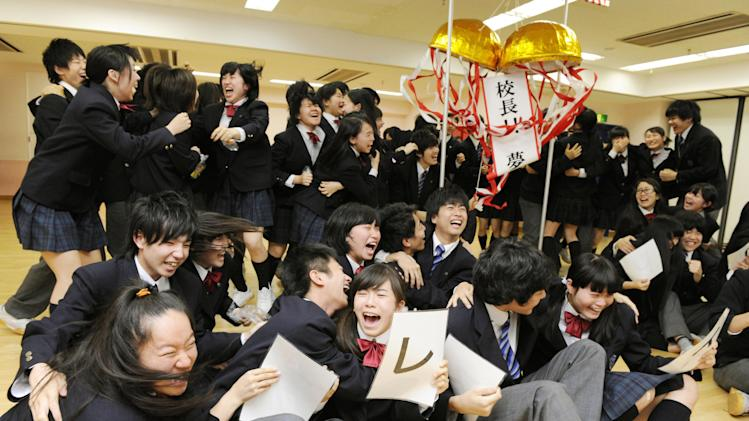 Students celebrate after a report that 80-year-old Japanese mountaineer Yuichiro Miura conquered the summit of Mount Everest, at CLARK Memorial International High School in Tokyo Thursday, May 23, 2013. Miura on Thursday became the oldest person to reach the top of Mount Everest - although his record may last only a few days. An 81-year-old Nepalese man, who held the previous record, plans his own ascent next week. Miura is the principal of the school. (AP Photo/Kyodo News)  JAPAN OUT, MANDATORY CREDIT