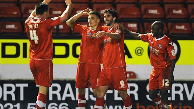 Walsall's Will Grigg (2nd right) celebrates with team mates after scoring his sides second goal against Portsmouth.