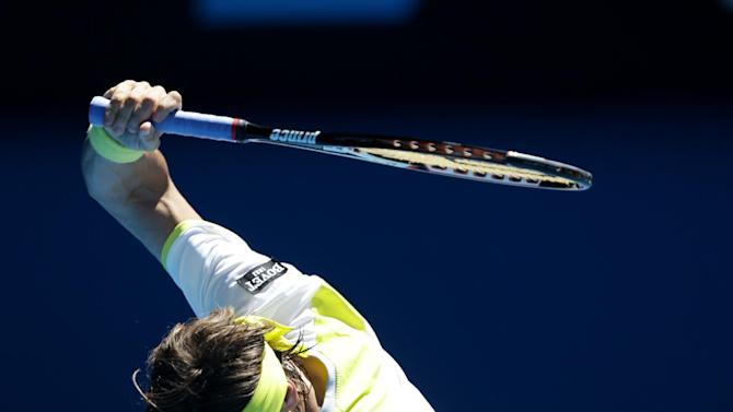 Spain's David Ferrer swings his racket in frustration during his quarterfinal match against compatriot Spain's Nicolas Almagro at the Australian Open tennis championship in Melbourne, Australia, Tuesday, Jan. 22, 2013. (AP Photo/Dita Alangkara)