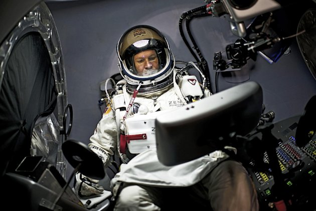 In a photo provided by Red Bull, pilot Felix Baumgartner of Austria, sits in his capsule during the preparations for the final manned flight of the Red Bull Stratos mission in Roswell, N.M. on Saturday, Oct. 6, 2012. Red Bull Stratos announced Friday that the jump by extreme athlete Baumgartner have been moved from Monday to Tuesday, Oct. 9, due to a cold front with gusty winds. The jump can only be made if winds on the ground are under 2 mph for the initial launch a balloon carrying Baumgartner. (AP Photo/Red Bull, Joerg Mitter)