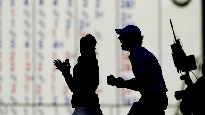 Europe's Rory McIlroy celebrates after winning the Ryder Cup PGA golf tournament Sunday, Sept. 30, 2012, at the Medinah Country Club in Medinah, Ill. (AP Photo/Chris Carlson)