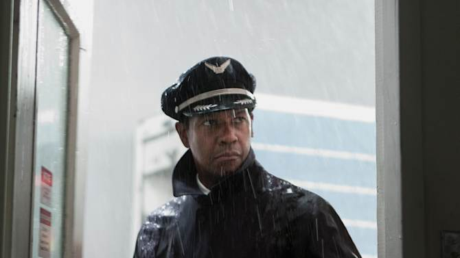 "This film image released by Paramount Pictures shows Denzel Washington portraying Whip Whitaker in a scene from ""Flight."" Washington plays an airline pilot who, despite being hung-over, drunk and coked-up, manages to bring down a rapidly deteriorating plane in a daring emergency landing on what should have been a routine flight between Orlando, Fla., and Atlanta.  (AP Photo/Paramount Pictures, Robert Zuckerman)"