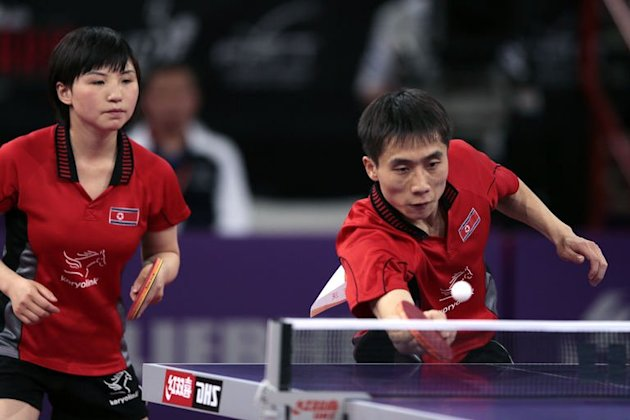 North Korea's Kim Hyok Bong (R) and Kim Jong (L) compete on May 18, 2013 in Paris