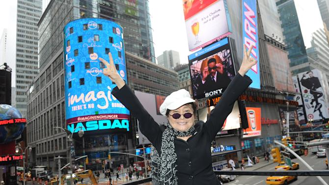 IMAGE DISTRIBUTED FOR HARD ROCK - Yoko Ono Lennon appears on the marquee of the Hard Rock Cafe New York, Monday, Nov. 19, 2012, in Times Square, to launch Hard Rock's fifth annual IMAGINE THERE'S NO HUNGER campaign.  Proceeds from the campaign benefit WhyHunger and its grassroots partners combating childhood hunger and poverty worldwide.    (Diane Bondareff/Invision for Hard Rock/AP Images)