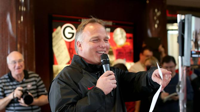 Georgia football coach Mark Richt answers questions from fans about Georgia's recruiting class on national signing day Wednesday, Feb. 5, 2014, in Athens, Ga
