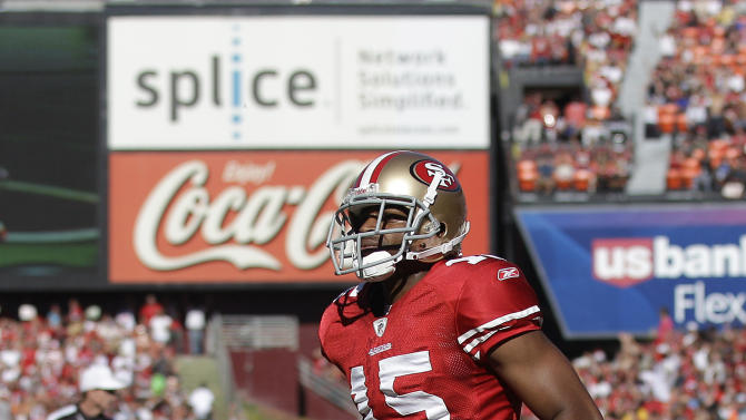 San Francisco 49ers wide receiver Michael Crabtree (15) scores on a two-yard touchdown pass from quarterback Alex Smith (11) in the second quarter of an NFL football game against the Cleveland Browns in San Francisco, Sunday, Oct. 30, 2011. (AP Photo/Marcio Jose Sanchez)