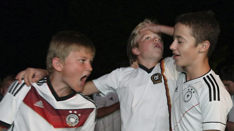 German soccer fans celebrate their team's World Cup victory against Argentina in Rio de Janeiro, Brazil, at the German embassy in Ankara, Turkey, early Monday, July 14, 2014. Germany won the final by 1-0. (AP Photo/Burhan Ozbilici)