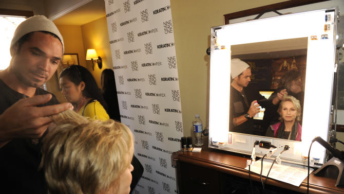 Actress Jane Lynch visits the Keratin Complex pop-up salon at the Fender Music lodge during the Sundance Film Festival on Monday, Jan. 21, 2013, in Park City, Utah. (Photo by Jack Dempsey/Invision for Fender/AP Images)