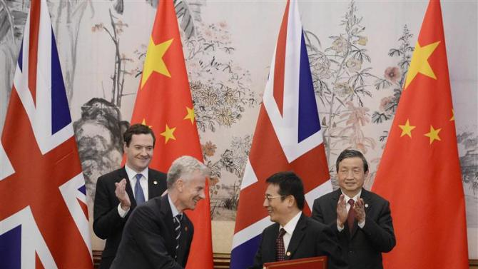 Osborne watches with Ma as Deighton shakes hands with Xu during a signing ceremony at the Diaoyutai Guesthouse in Beijing