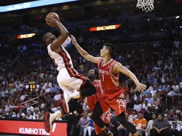 Houston Rockets' Jeremy Lin (7) is unable to block MIami Heat's Dwywane Wade (3) during the first half of an NBA  basketball game in Miami, Sunday, March 16, 2014