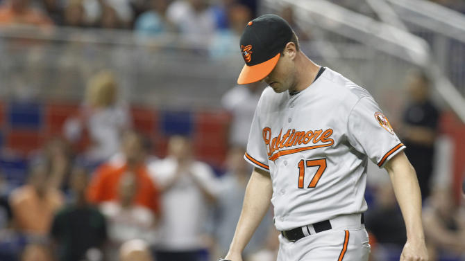 Baltimore Orioles relief pitcher Brian Matusz leaves the baseball game against the Miami Marlins in the 12th inning Saturday, May 23, 2015, in Miami. Matusz left the game after his right forearm was inspected by umpires. The Marlins won 1-0. (AP Photo/Joe Skipper)