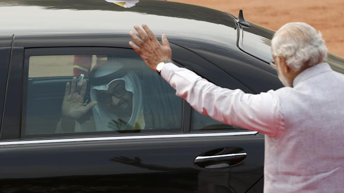 Sheikh Mohammed bin Zayed Crown Prince of Abu Dhabi waves to India's Prime Minister Modi after his ceremonial reception at the forecourt of India's Rashtrapati Bhavan presidential palace in New Delhi