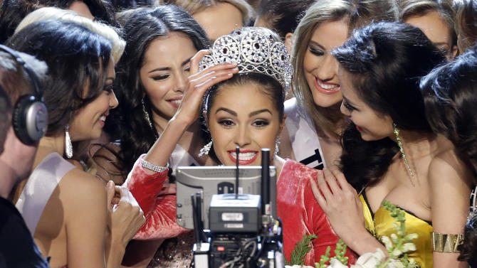 Miss USA, Olivia Culpo, center, smiles for the television camera as she is congratulated by other contestants after being crowned as Miss Universe during the Miss Universe competition, Wednesday, Dec. 19, 2012, in Las Vegas. (AP Photo/Julie Jacobson)
