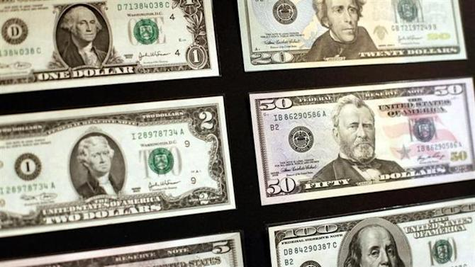 United States dollar banknotes are seen at the Museum of American Finance in New York October 15, 2010.