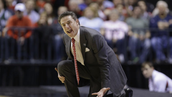 Louisville head coach Rick Pitino directs his team during the second half of a regional semifinal against Oregon in the NCAA college basketball tournament, Friday, March 29, 2013, in Indianapolis. (AP Photo/Michael Conroy)