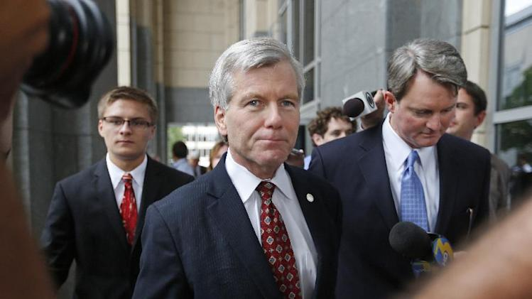 Former Virginia Gov. Bob McDonnell leaves the federal courthouse in Richmond, Va., with his lawyer John L. Brownlee on the second day of his and his wife Maureen's corruption trial, Tuesday, July 29, 2014. (AP Photo/Richmond Times-Dispatch, Alexa Welch Edlund)
