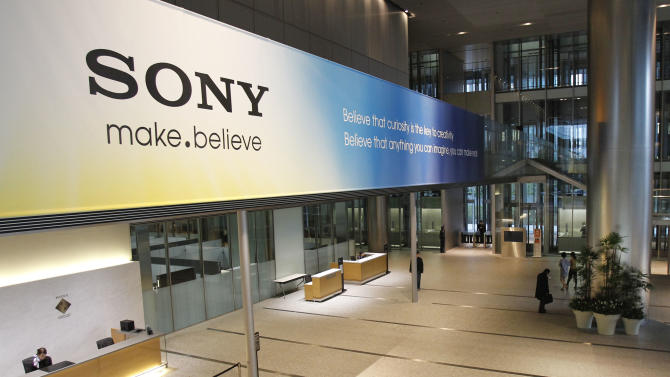 FILE - In this April 10, 2012 file photo, the main lobby of the headquarters of Sony Corp. in Tokyo is hung with a large sign reading: Sony make.believe. Sony now has a new president - Kazuo Hirai, the former head of its game division. But shareholders are already raising doubts about his ability to revive the Japanese electronics and entertainment giant. (AP Photo/Koji Sasahara, File)