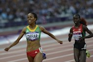 Ethiopia&#39;s Meseret Defar (L) celebrates as she wins the gold medal in the women&#39;s 5000m final at the athletics event of the London 2012 Olympic Games on August 10, 2012 in London