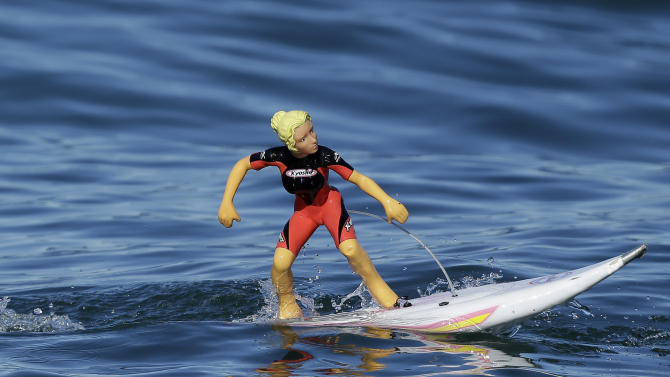 A remote-controlled toy surfer goes through the water during the Mavericks Invitational big wave surf contest in Half Moon Bay, Calif., Sunday, Jan. 20, 2013. (AP Photo/Marcio Jose Sanchez)