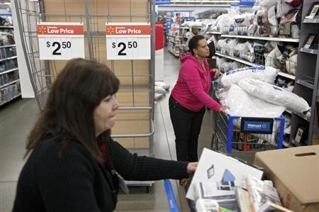 Shoppers make their way past an endcap that once held discounted pillows at a Walmart Store in Chicago,