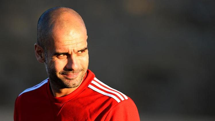 Bayern Munich's head coach Pep Guardiola arrives for a training session, on the eve of the FIFA Club World Cup final match against Morocco's Raja Casablanca, in the Moroccan city of arrakesh on December 20, 2013