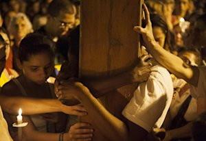 Catholics embrace the World Youth Day Cross also known …