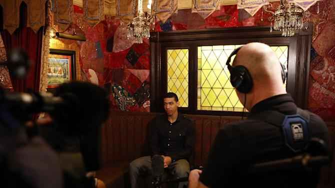 IMAGE DISTRIBUTED FOR NBA ALL STAR BRUNCH - San Antonio Spurs shooting guard Danny Green does an interview during the 2013 NBA All Star Weekend at the House of Blues on Sunday, Feb. 17, 2013 in Houston. (Photo by Aaron M. Sprecher/Invision for BDA Sports-BFI All Star Brunch/AP Images)