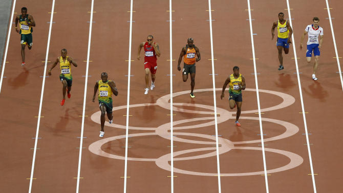 Jamaica's Warren Weir, second left, Jamaica's Usain Bolt, third left, and Jamaica's Yohan Blake lead the men's 200-meter final during the athletics in the Olympic Stadium at the 2012 Summer Olympics, London, Thursday, Aug. 9, 2012. Led by Bolt, Jamaica took gold, silver and bronze medals in the race. (AP Photo/Daniel Ochoa De Olza)