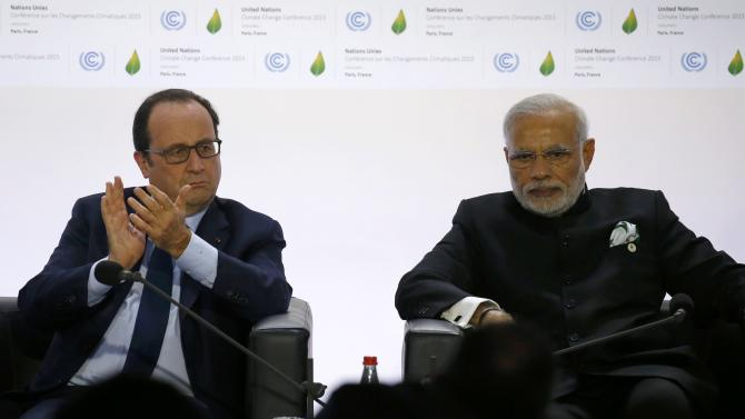 French President Francois Hollande and India's Prime Minister Narendra Modi attend the launching of the International Solar Alliance on the opening day of the World Climate Change Conference 2015 at Le Bourget