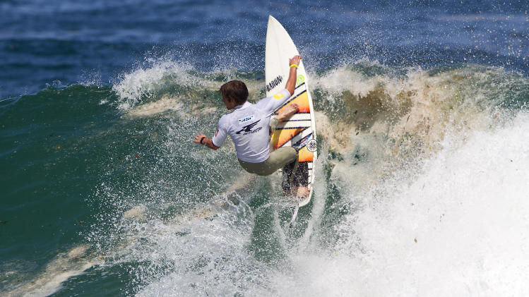 Matt-Lewis Hewitt, of New Zealand, competes to win his third-round to advance into Round 4 at the Arnette World Junior Championships surfing competition in Rio de Janeiro, Brazil, Saturday, Oct. 29, 2011. (AP Photo/Association of Surfing Professionals, Sean Rowland)