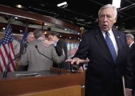 House Minority Whip Steny Hoyer of Md., right, answers questions after a news conference on Capitol Hill in Washington, Wednesday, Nov. 16, 2011. Huddling behind him, from left are, Rep. Tim Walz, D-Minn., Sen. Sen. Kent Conrad, D-N.D, and Sen. Mark Warner, D-Va. (AP Photo/Carolyn Kaster)